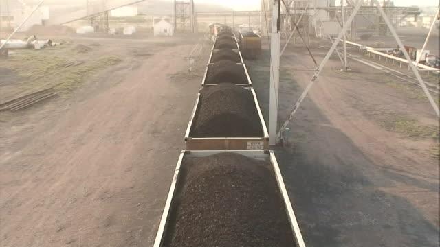 coal fills train cars. - coal stock videos & royalty-free footage