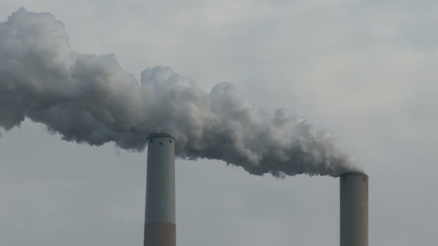 Coal Fired Power Plant Smoke Stack Fumes into air