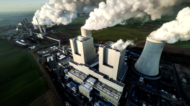 aerial: coal fired power station - power station stock videos & royalty-free footage