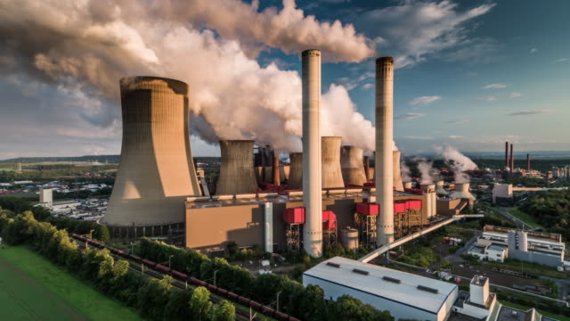 aerial: coal fired power station - coal fired power station stock videos and b-roll footage