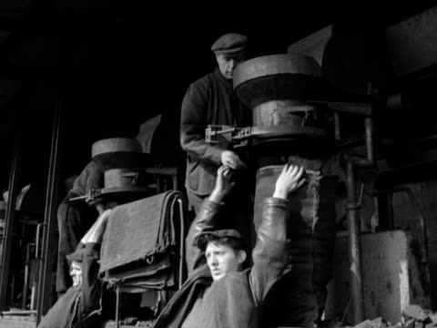 Coal is poured into sacks and loaded onto a cart at Belfast docks