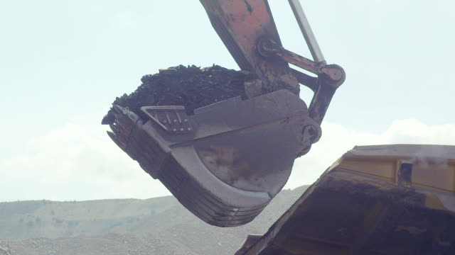 Coal loading excavator, loading of coal