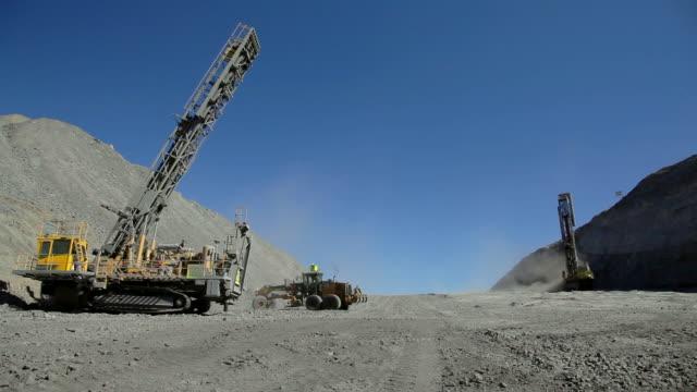 coal mine drilling rigs and bulldozer - pala meccanica video stock e b–roll