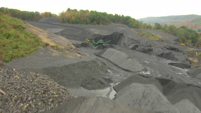 ms aerial coal mine surrounded by trees near town / mechanicsville, pennsylvania, united states - coal mine stock videos and b-roll footage