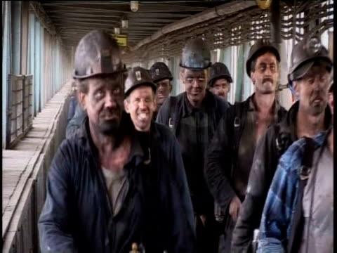 coal miners covered in dust walking along corridor at end of shift silesia; 2005 - coal mine stock videos and b-roll footage