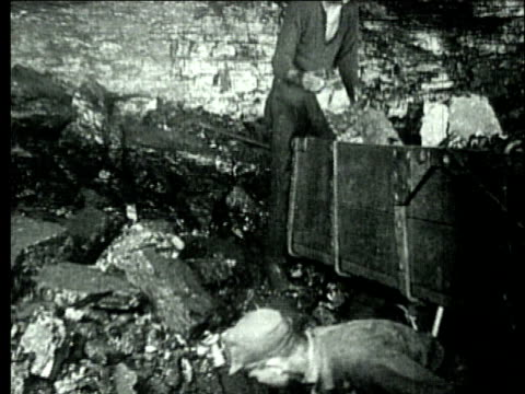 1927 b/w montage ms coal miners filling mine cart with bituminous coal/ pennsylvania, usa - helmet stock videos & royalty-free footage