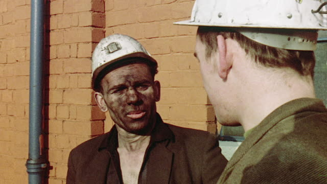 1970 montage coal miners greeting and chatting outside new stubbin colliery / exiting front steps of rotherham college of arts and technology / playing rugby / south yorkshire, england, united kingdom - yorkshire england stock videos & royalty-free footage