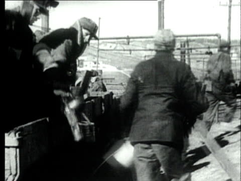 1927 b/w ws coal miners holding tin pails, jumping out of mine cart/ pennsylvania, usa - tin mine stock videos & royalty-free footage