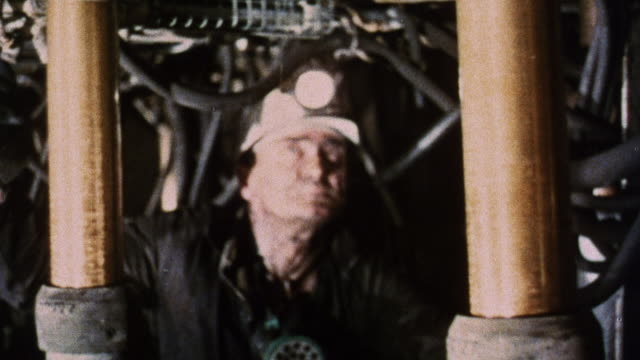 1973 montage coal miners on the mine face breathing dust kicked up by excavating machines / united kingdom - coal mine stock videos and b-roll footage
