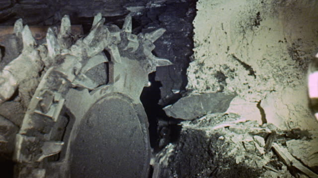 1971 montage coal miners operating machinery underground with safety in mind / united kingdom - digging 個影片檔及 b 捲影像