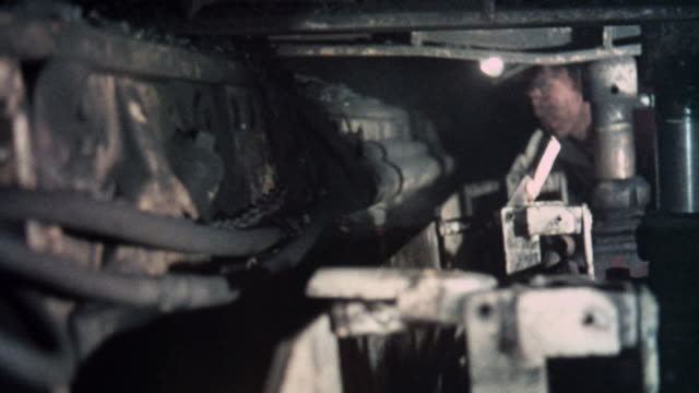vidéos et rushes de 1973 montage coal miners operating mining machinery as briquettes are transported / united kingdom - mineur de charbon