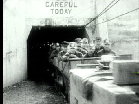 1927 B/W WS Coal miners travelling past camera in mine cart exiting tunnel/ Pennsylvania, USA