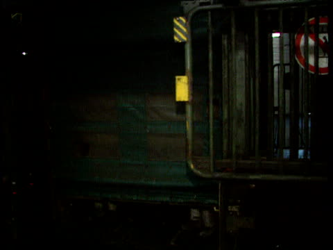 coal miners wearing hard hats and protective clothing walk out of pit lift and past camera - bergbau stock-videos und b-roll-filmmaterial
