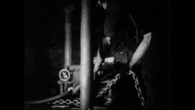 montage coal miners working with an electric coal cutter / scotland, united kingdom - 1935 stock-videos und b-roll-filmmaterial