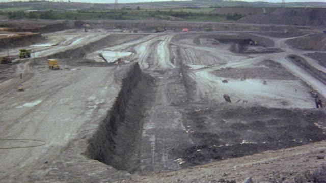 1979 AERIAL Coal mining canyon and dynamite exploding / England, United Kingdom
