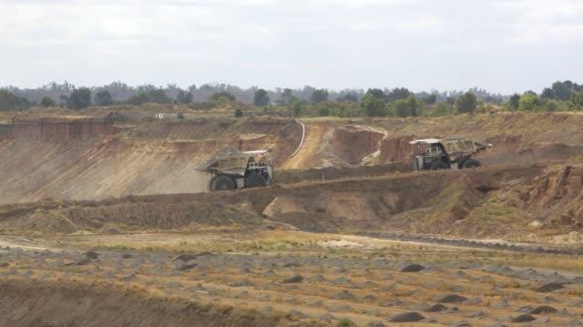 Coal mining dump trucks passing
