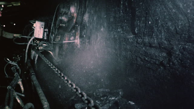 montage coal moving through machines and conveyor belts / united kingdom - coal mine stock videos & royalty-free footage