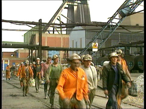 Coal Pit Closures ENGLAND CMS Group of miners towards and past at end S Yorks of shift PULL OUT ITN CMS Vox pops SOF LAMS Flag with legend 'British...
