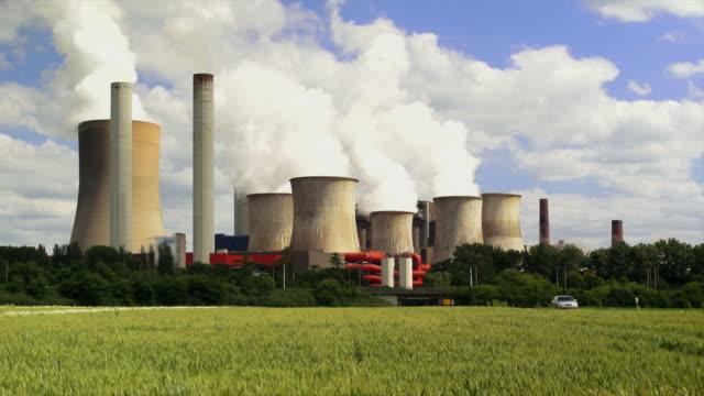 coal power plant and wheat field tl - luftverschmutzung stock videos & royalty-free footage