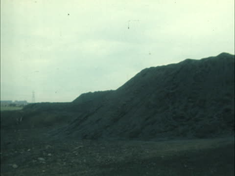 Kent L heaps coal at pit head Pile coal PAN LR Various coal piles Open cast mine London Battersea Power Station Sign 'NUM Do Not Cross Picket Line At...