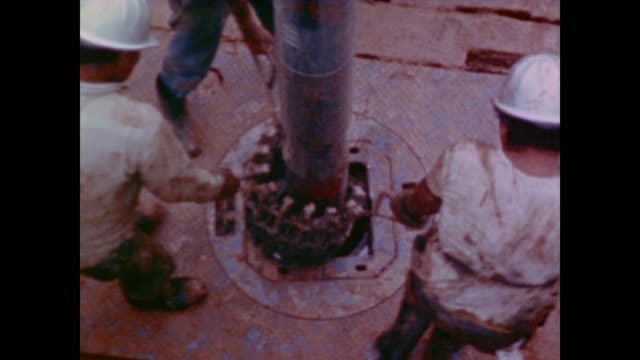 1974 coal travels along the line and water crashes through the dam to make electricity - 発電所関係の職業点の映像素材/bロール