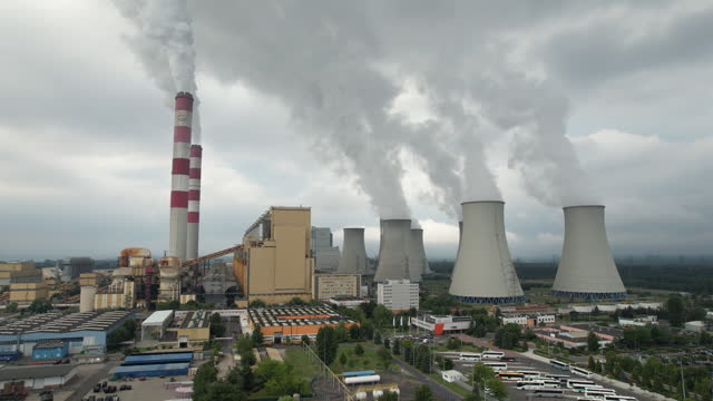coal-fired belchatow power station, aerial view, in belchatow, lodzkie, poland on thursday, july 8, 2021. the coal-fired power station is the largest... - smoke stack stock videos & royalty-free footage