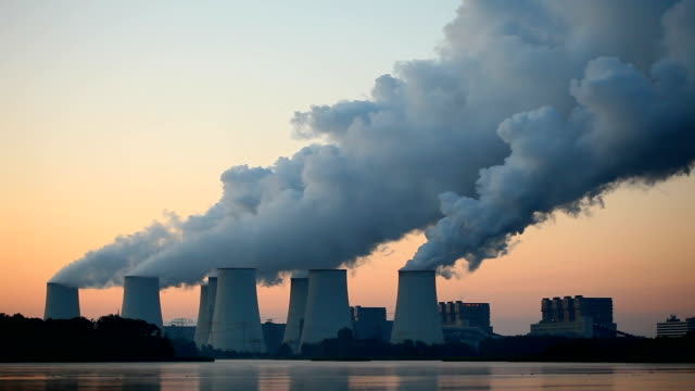 coal-fired power plant at sunrise - smoke stack stock videos and b-roll footage