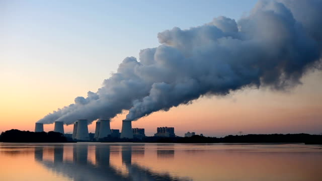 coal-fired power plant at sunrise - smoke stack stock videos & royalty-free footage
