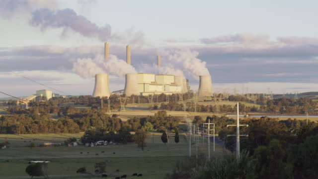 ws a coal-fired power station at sunset / traralgon, australia - coal fired power station stock videos & royalty-free footage