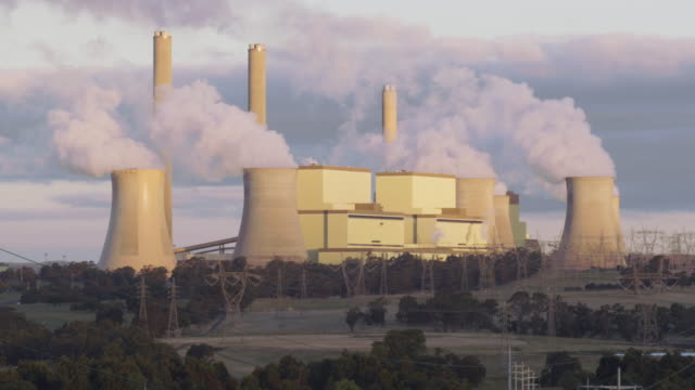 ls a coal-fired power station at sunset / traralgon, australia - coal fired power station stock videos & royalty-free footage