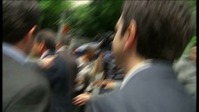 coalition negotiations / bailout deal in doubt greece athens ext alexis tsipras along through press scrum and into car reporter to camera - ファイサル・イスラム点の映像素材/bロール