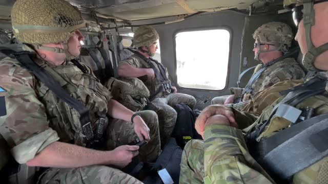 coalition soldiers fly to baghdad international airport from the international zone in a u.s. blackhawk helicopter on may 31 in baghdad, iraq.... - baghdad stock videos & royalty-free footage