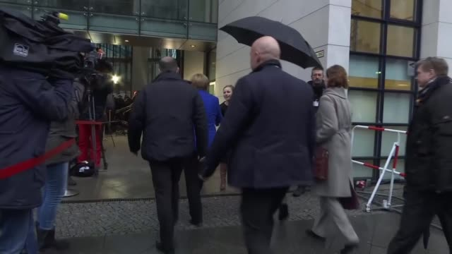 Coalition talks nearing deadline date GERMANY Berlin EXT Angela Merkel from car and past press into Willy BrandtHaus building EU and German flags...