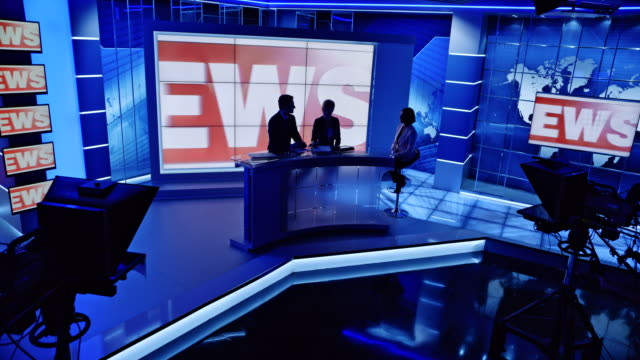 cs co-anchors ending the news with the interview and the lights go off in the studio - media interview stock videos and b-roll footage