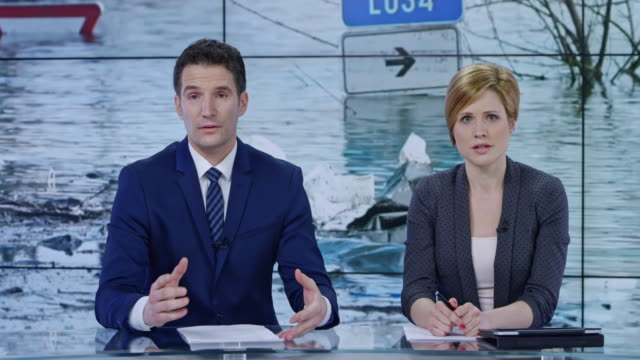 LD Co-anchors presenting the news on recent severe flooding