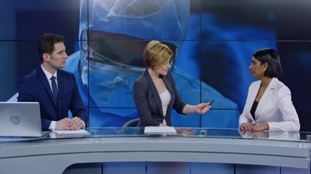 ld co-anchors talking with a female expert on the healthcare topic in the studio - media interview stock videos and b-roll footage