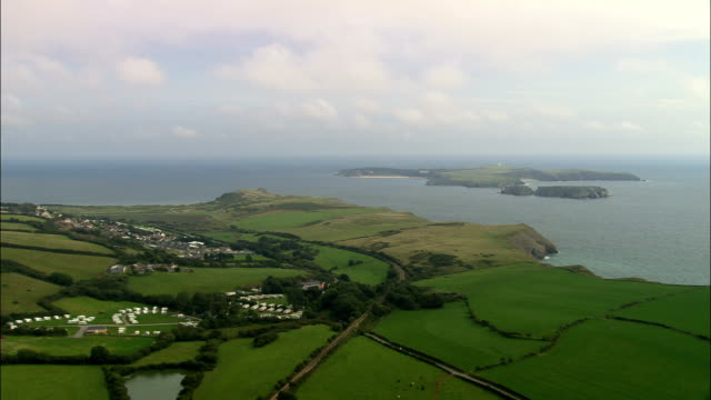 coast around caldey island  - aerial view - wales, county of pembrokeshire, united kingdom - pembrokeshire stock videos and b-roll footage