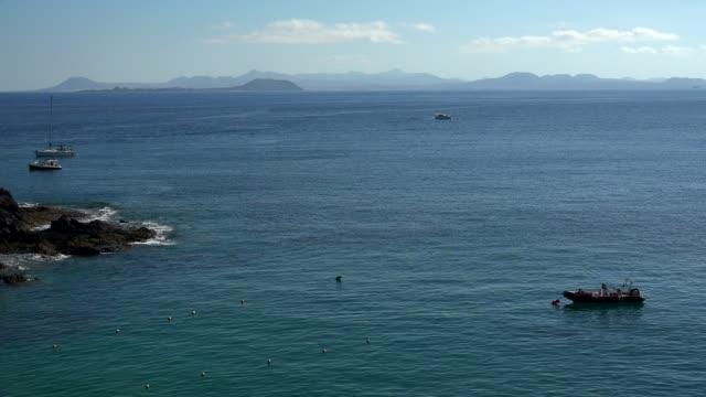 coast at playas de papagayo, lanzarote, canary islands, spain, atlantic, europe - atlantic islands stock videos & royalty-free footage