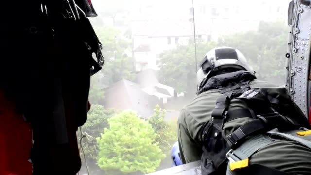us coast guard air station houston texas works to rescue victims of the aftermath of hurricane harvey raw footage of various helicopter rescues as... - distruzione video stock e b–roll