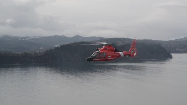 coast guard air station port angeles, washington aircrews conduct training off of neah bay, washington with their eurocopter mh-65 dolphin... - safety harness stock videos & royalty-free footage