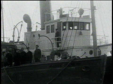 vidéos et rushes de coast guard alongside seized ship in new york city harbor / new york new york united states - 1931