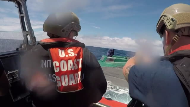 coast guard boarding teams with cutter bertholf intercept a low profile go-fast vessel while patrolling international waters of the eastern pacific... - coast guard stock videos & royalty-free footage