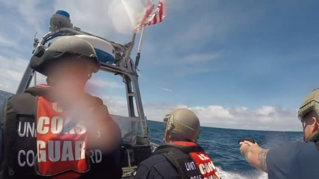 vídeos de stock e filmes b-roll de coast guard boarding teams with cutter bertholf intercept a low profile go-fast vessel while patrolling international waters of the eastern pacific... - crime or recreational drug or prison or legal trial