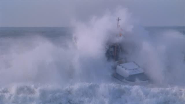 MS, Coast Guard boat against wave, California, USA