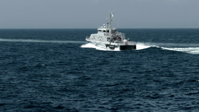 coast guard boat at full speed in the open sea - military ship stock videos & royalty-free footage