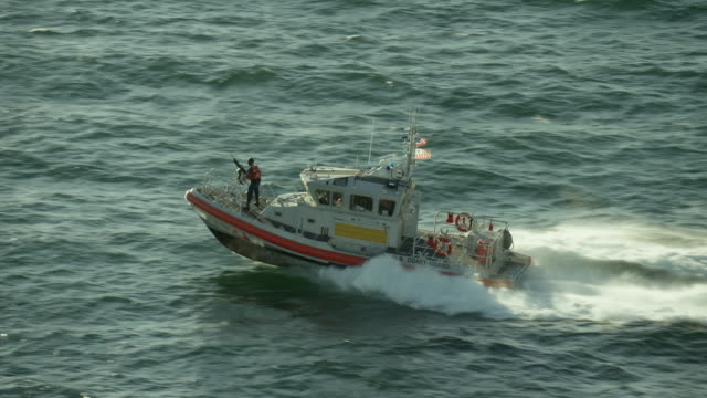 us coast guard boat powers through water - coast guard stock videos & royalty-free footage