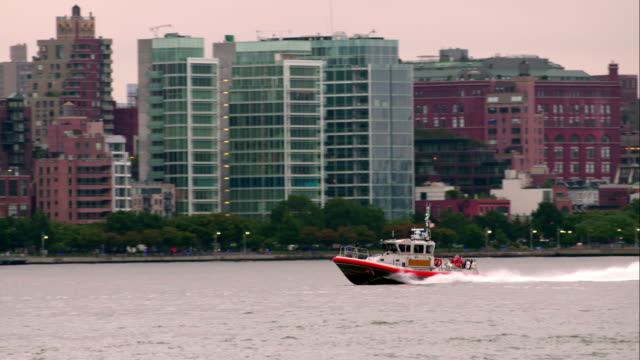Coast Guard boat speeds quickly along Hudson River in New York City