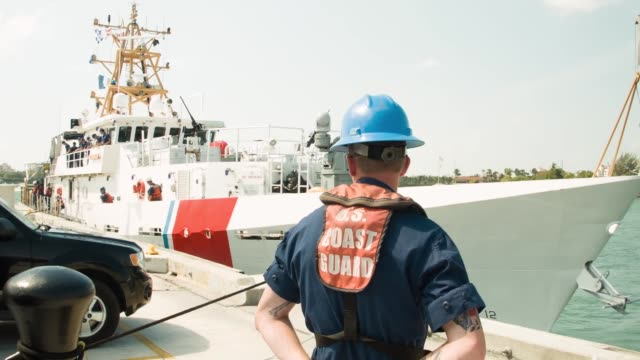 s coast guard crew members off loading marijuana from the paul clark one of the coast guard's newest fastresponse cutters on may 9 2014 in miami... - cooking utensil stock videos & royalty-free footage