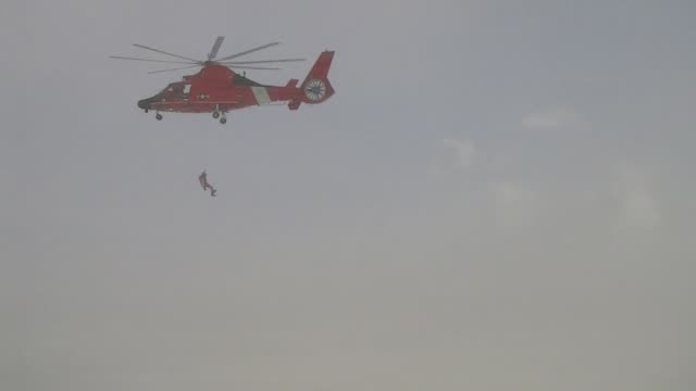 coast guard crews from air station detroit and station st. clair shores conduct training on lake st. clair near selfridge air national guard base,... - helicopter stock videos & royalty-free footage