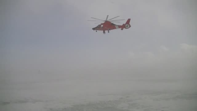 coast guard crews from air station detroit and station st clair shores conduct training on lake st clair near selfridge air national guard base feb... - hovering stock videos & royalty-free footage